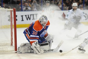 Jan 29, 2014; Edmonton, Alberta, CAN; Edmonton Oilers goalie Ben Scrivens (30) stops a shot during the third period against the San Jose Sharks at Rexall Place. The Oilers won 3-0. Mandatory Credit: Candice Ward-USA TODAY Sports ORG XMIT: USATSI-138256 ORIG FILE ID:  20140129_lbm_wb4_281.JPG